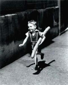 Willy Ronis photograph boy with the baguette