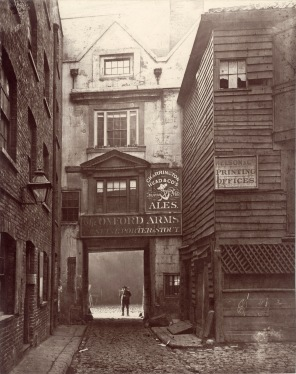 This photograph shows the entrance of The Oxford Arms Inn which stood in a short lane leading out of the west side of Warwick Lane, where this photograph was taken from. The inn was demolished in 1878. This is one of a collection of images commissioned by the Society for Photographing Relics of Old London to record historic buildings that were being threatened with demolition.
